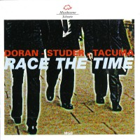 Purchase Christy Doran - Race The Time (With Fredy Studer & Jamaaladeen Tacuma)