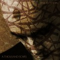 Buy Eric Clayton - A Thousand Scars Mp3 Download